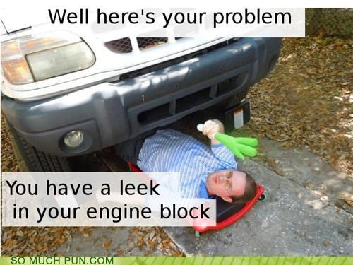 photo of a man under a car and discovers a leek
