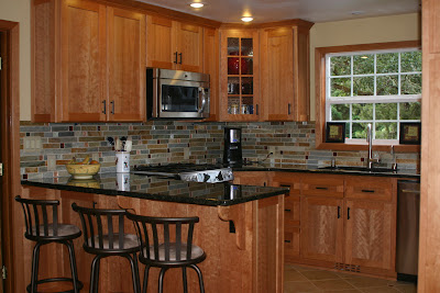Chosing a backsplash with black granite counters on Backsplash Ideas For Black Granite Countertops And Maple Cabinets  id=68618