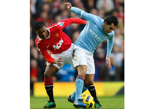 Patrice Evra with Carlos Tevez, Manchester Utd - Manchester City