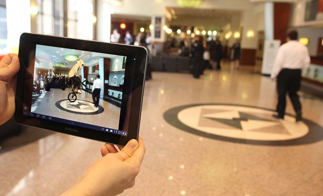 augmented reality for hotels: BMX World Champion Shanaze Reade can be seen performing tricks on her bike in the hotel's lobby