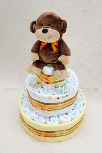 Diaper Cake with Monkey baby clothes and blankets