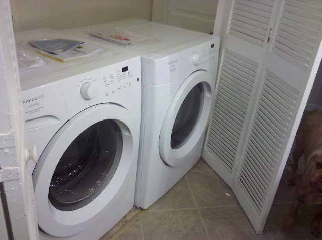 Washer On Left Dryer Right With Closet Doors Open