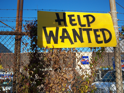 Help Wanted Sign on Big Yellow Placard
