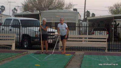 Cynthia playing shuffleboard.