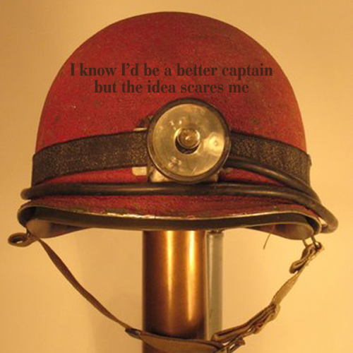Secret 41 - Image: an old miner's helmet and headlamp. Text: I know I'd be a better captain, but the idea scares me. Font: serif.