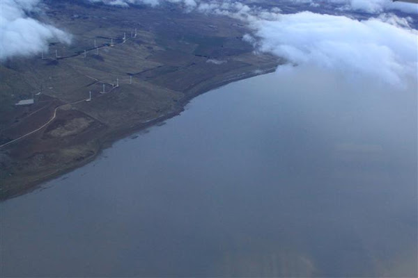 lake george with water and windfarm