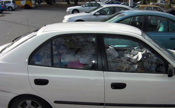 car filled with loose rubbish