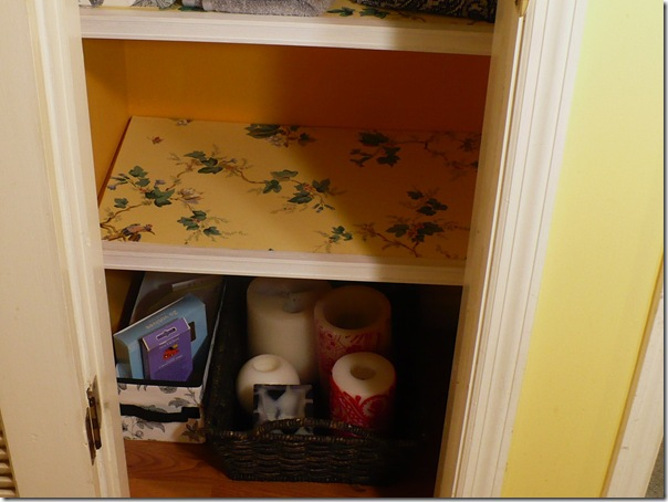 organized linen closet shelf
