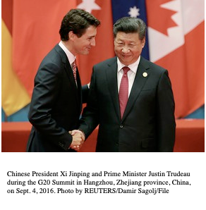 Two men shaking hands  Description automatically generated with medium confidence