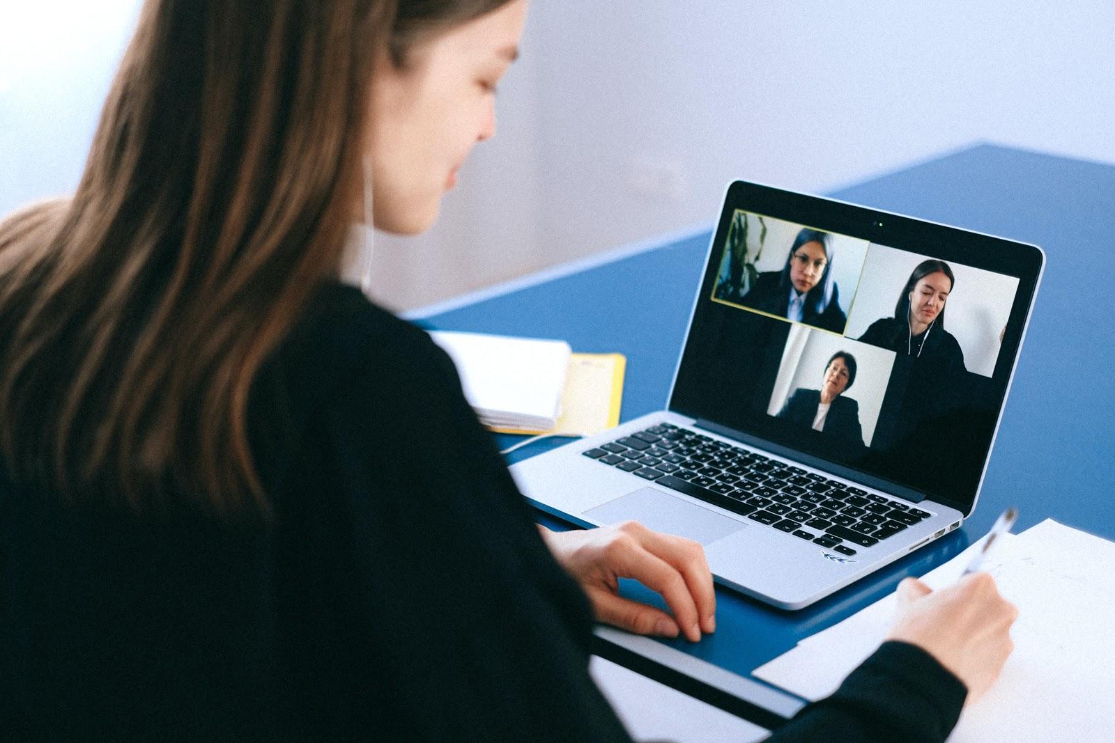 woman working online on laptop