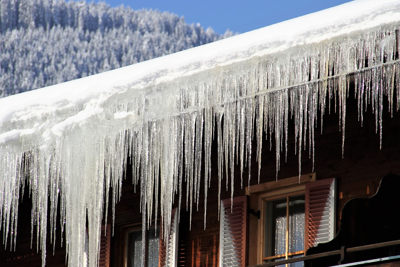 Ice damage on your roof may cause the need for a roof replacement
