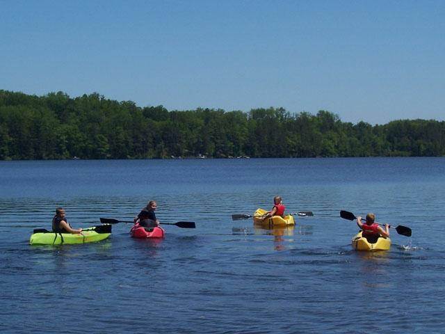 C:\Users\Family\Desktop\kids-kayaking-booth-lake.jpg