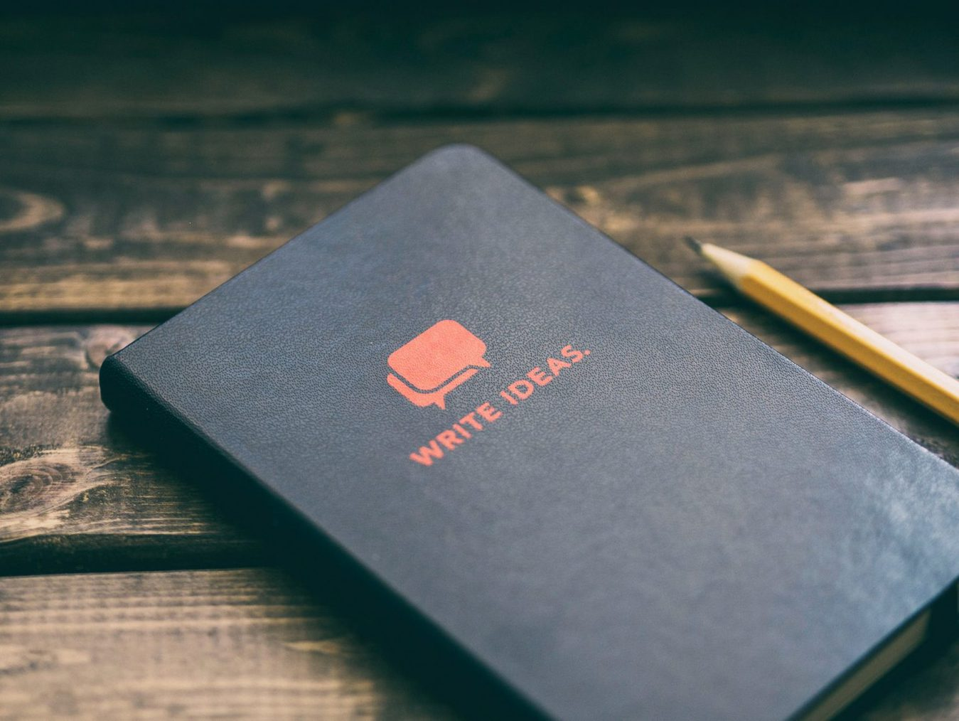 Notebook for ideas on a wooden table