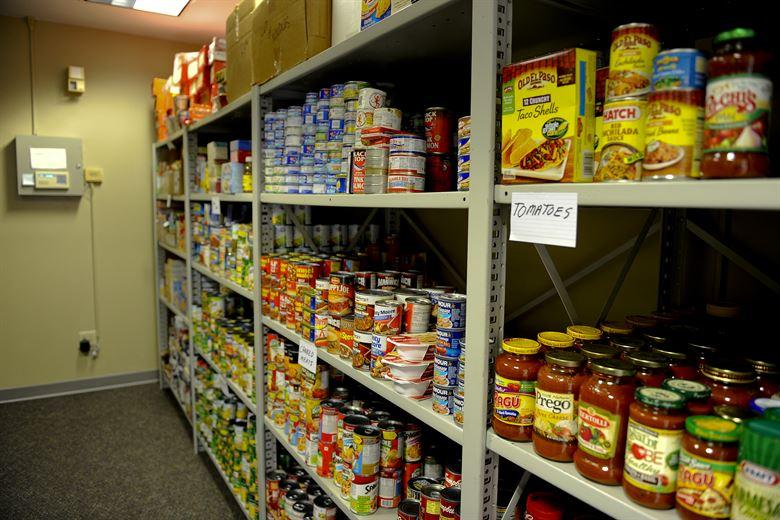 More than 3,000 pounds of non-perishable food sits on the shelves of the base food pantry located in the same building as the Airman's Attic on Hurlburt Field, Fla., July 24, 2013. Due to sequestration and civilian furloughs, the food pantry recently opened its doors to civilian personnel. (U.S. Air Force photo by Airman 1st Class Jeffrey Parkinson)