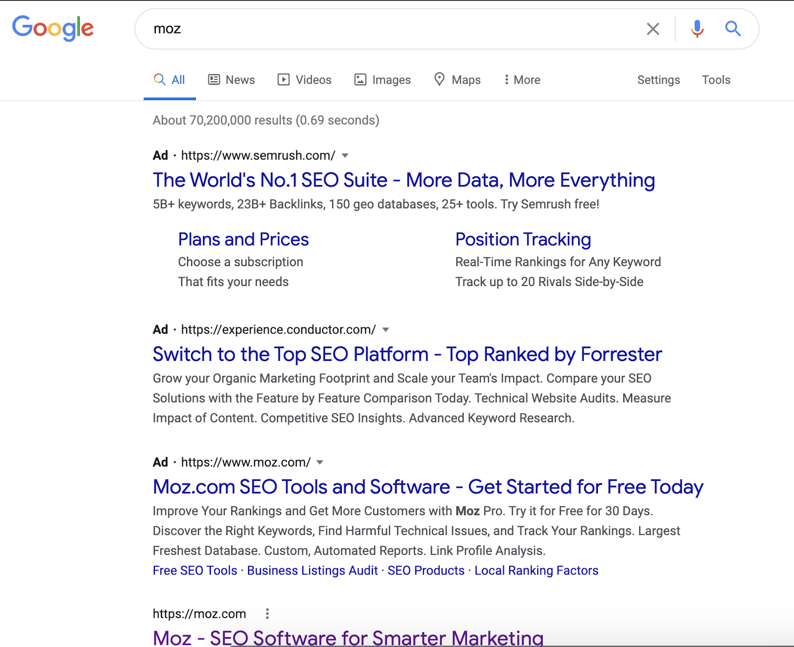 "Google search results of paid ads running against an organic search for ""Moz."""