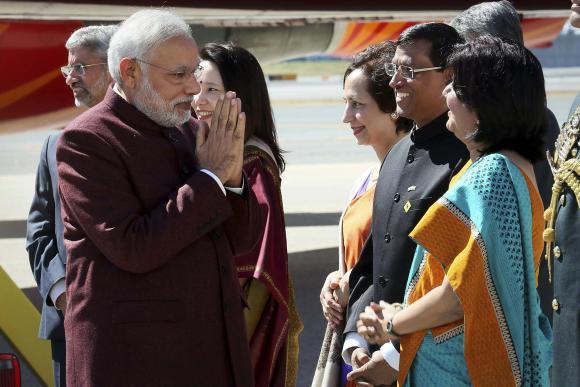 Indian Prime Minster Narendra Modi (L) is greeted by dignitaries as he arrives at JFK airport in New York September 26, 2014, a day before his appearance at the United Nations General Assembly.  REUTERS/Mohammed Jaffer-SnapsIndia