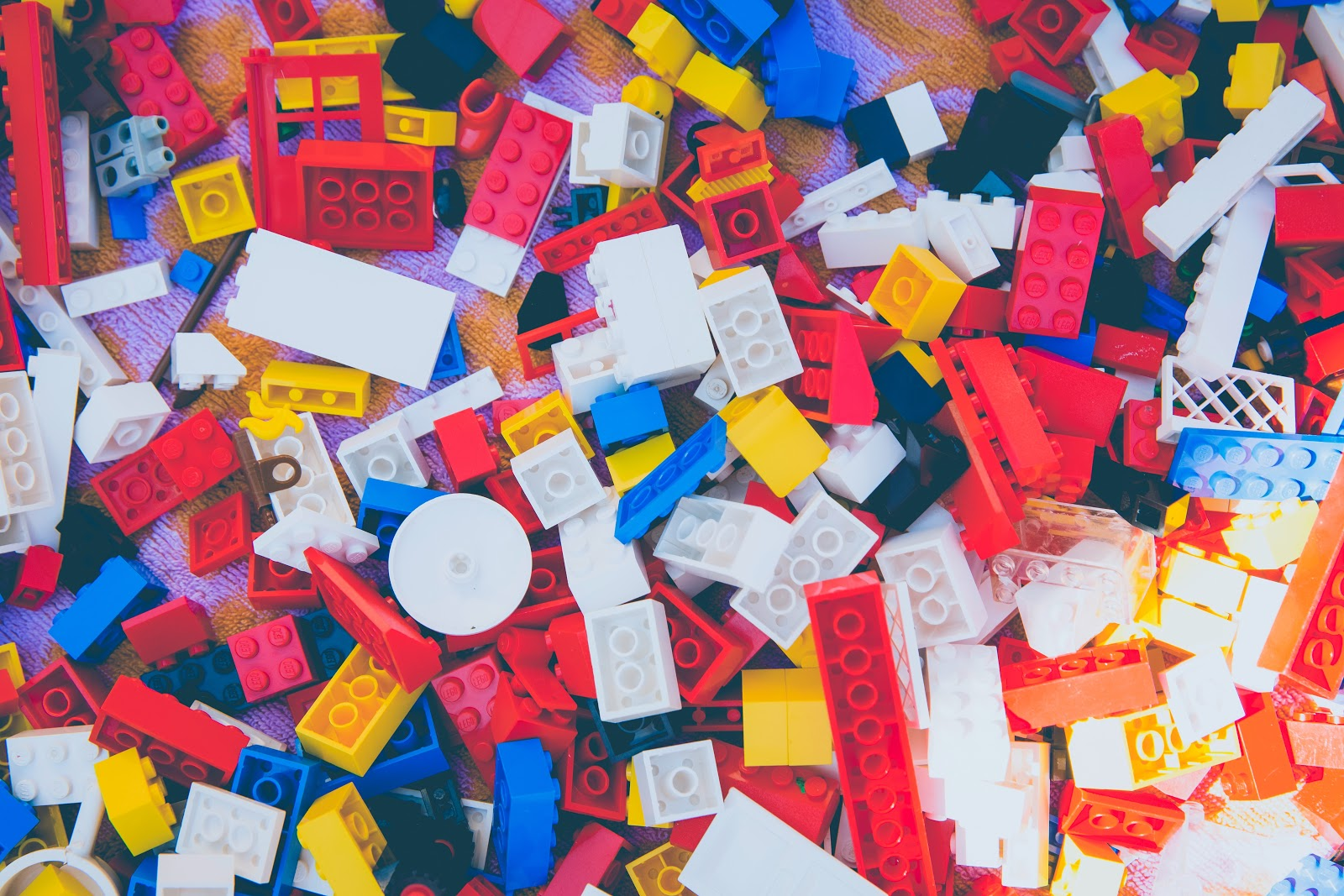 An assortment of multicolored legos fills this image.