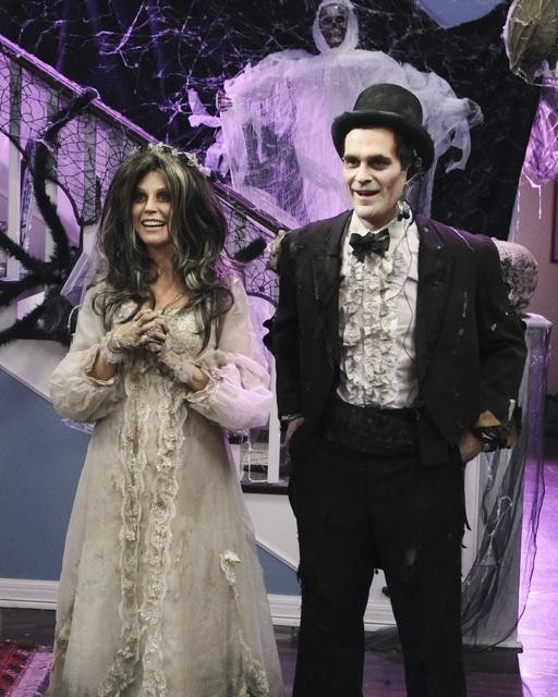 "Photo of Claire and Phil from ""Modern Family"" wearing zombie bride and groom costumes."