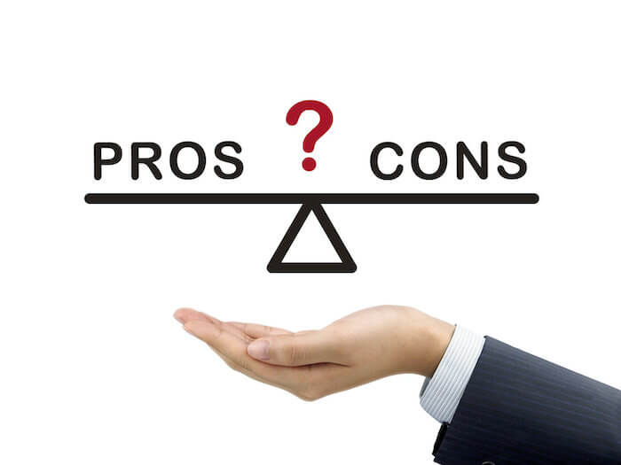 Illustration of hand weighing a scale of pros and cons