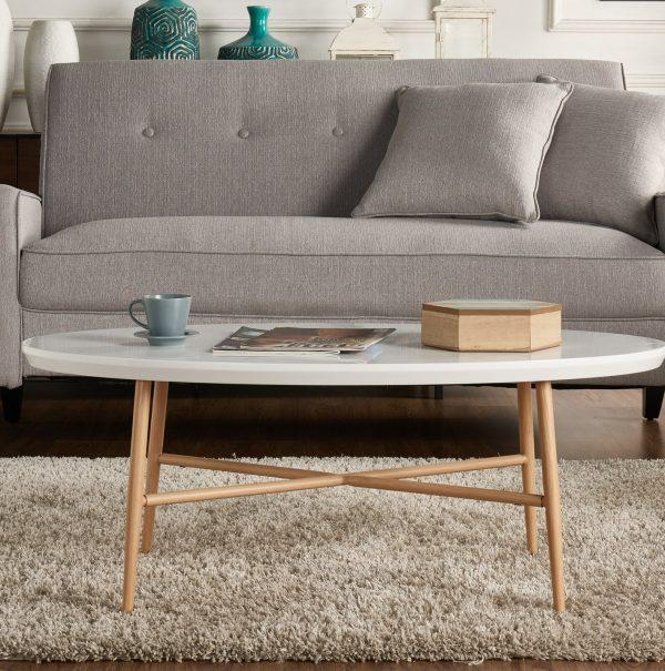 http://cdn.home-designing.com/wp-content/uploads/2021/04/small-oval-coffee-table-with-white-top-and-wood-legs-durable-cheap-living-room-furniture-for-Scandinavian-decor-ideas-600x605.jpg