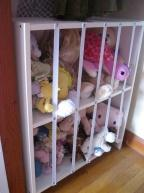 Another Great Way to Use #Elastic - to keep organized! Just need elastic, upholster tacks, bookshelf = stuffed animal storage