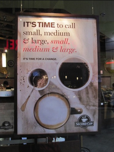 """Second Cup's poster saying """"It's time to call small, medium & large, small, medium & large. It's time for a change."""""""
