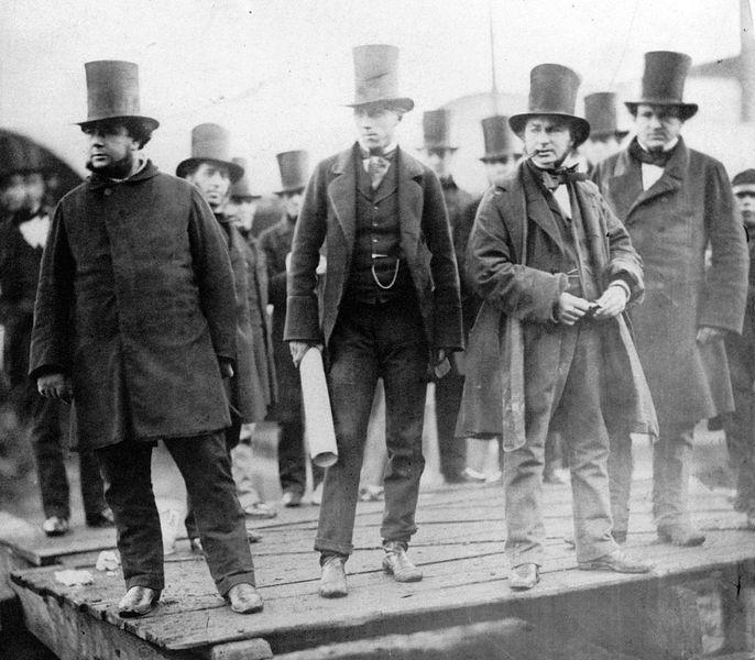 Bourgeois men in top hats.