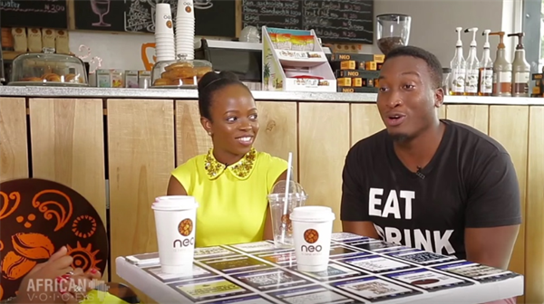 Folly & Nosa, founders of premiere Nigerian food blog EatDrinkLagos sitting at a table at restaurant Neo. Top 25 Social Media Influencers Making Impacts in Nigeria Today