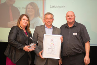 'Franchisees of the Year', Paul and Shirley McKenna collect their award from Driver Hire's Chief Executive, Chris Chidley (centre)