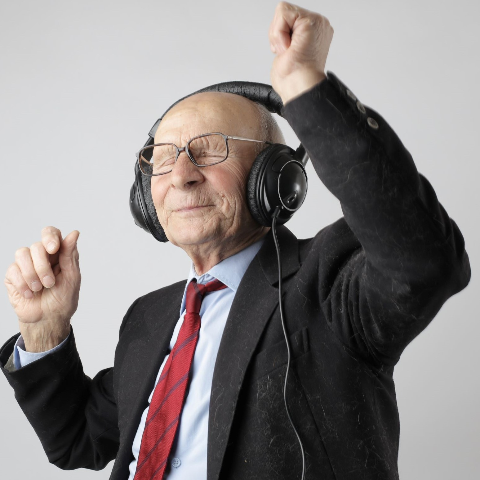 A senior man dancing because it's good for his heart