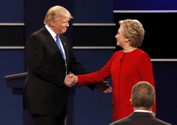 Republican U.S. presidential nominee Donald Trump shakes hands with Democratic U.S. presidential nominee Hillary Clinton at the start of their first presidential debate at Hofstra University in Hempstead, New York, U.S., September 26, 2016. REUTERS/Mike Segar