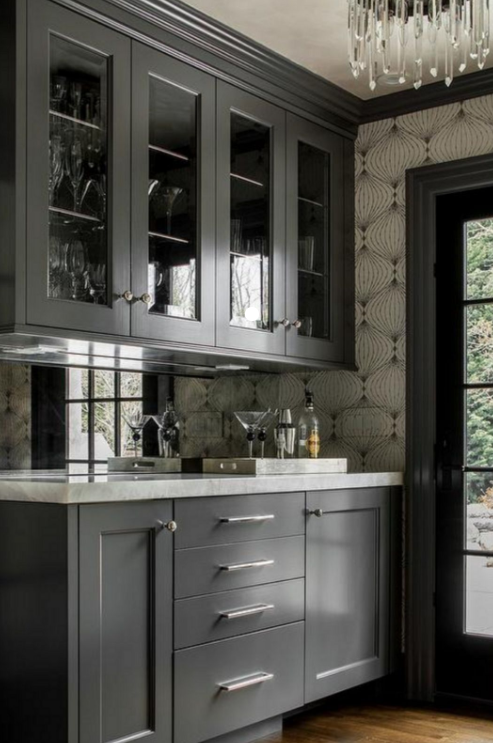 grey glass door cabinets with silver knobs and pulls french door wood floors and patterned wallpaper