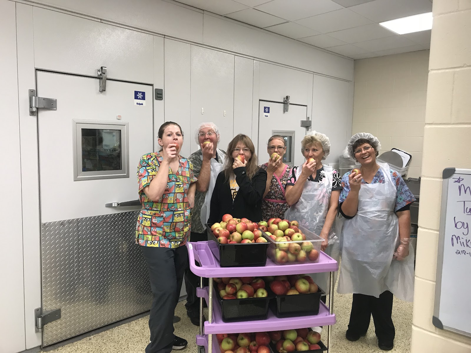Staff from Clearbrook-Gonvick celebrate Farm to School with the Great Lakes Great Apple Crunch.