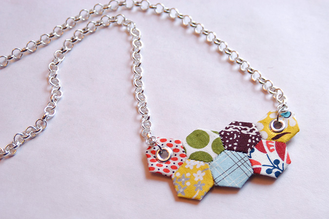 Have a look on hex necklace from a jewelry display collection.