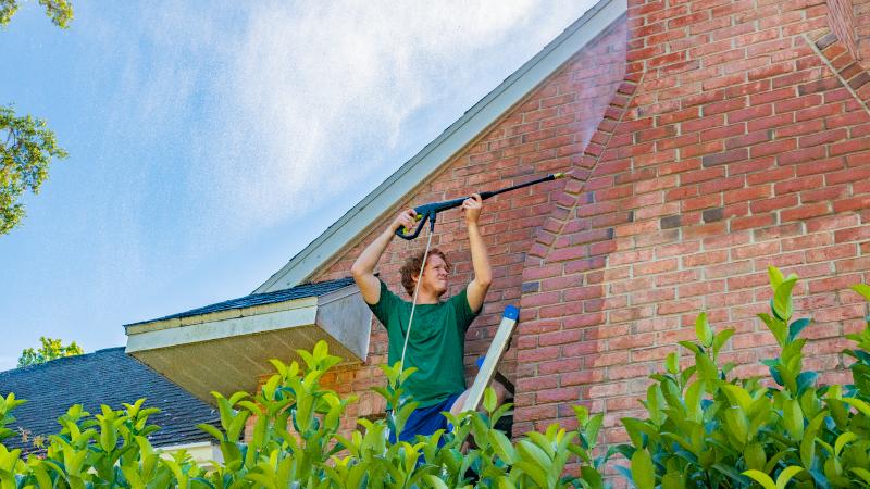 pressure washing a brick house