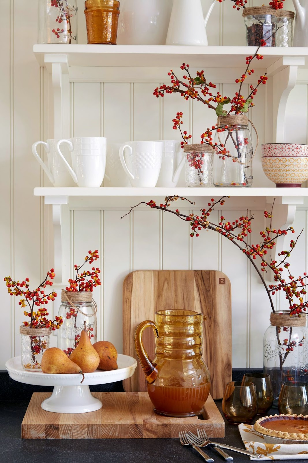 kitchen counter with fall decorations and berries.