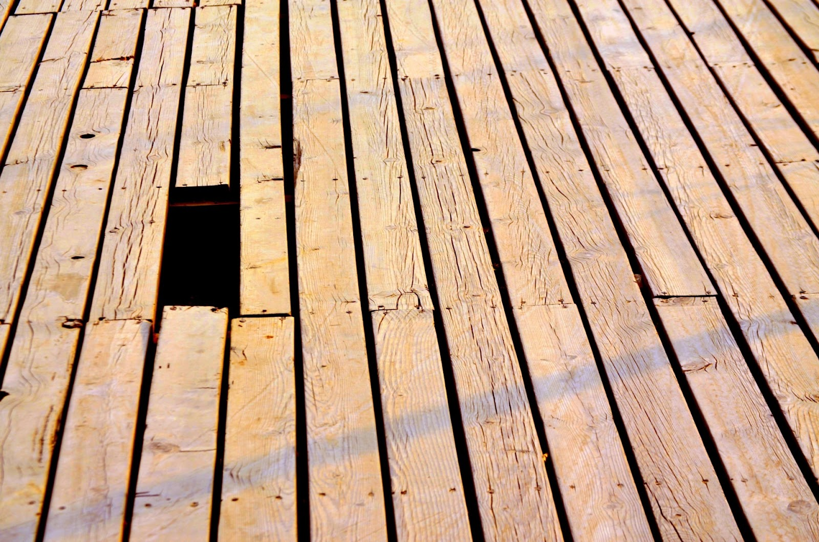 Hole in some wooden decking where it was weak