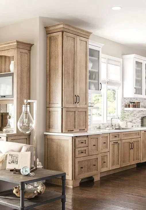 modern farmhouse kitchen with natural wood shaker cabinets and white shaker cabinets.