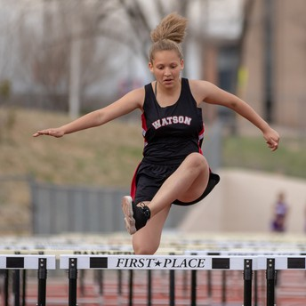 Watson Track Player Running Over Hurdles
