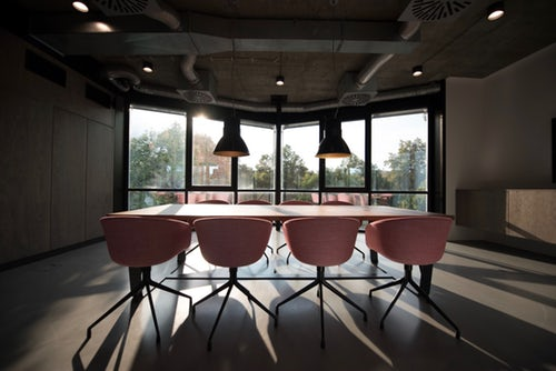 table and chairs in an empty meeting room