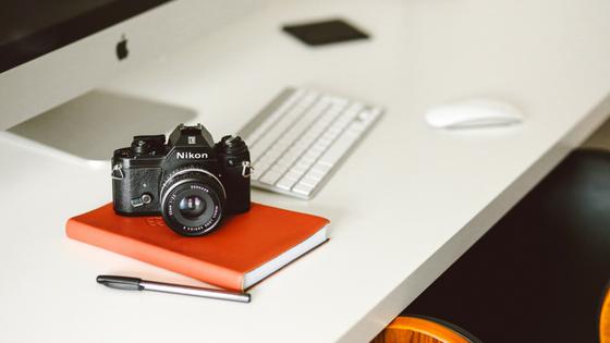 Camera sitting next to a keyboard