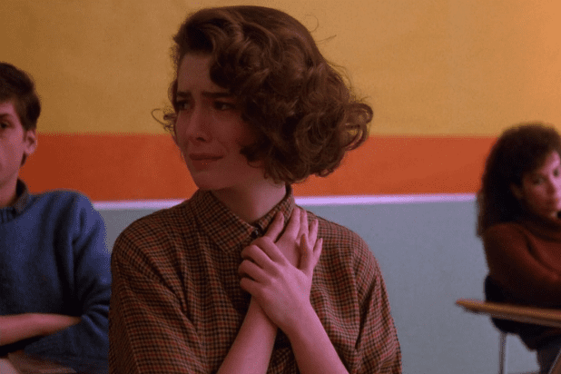 donna hayward holds her hands to her chest and cries in her school classroom in Twin Peaks