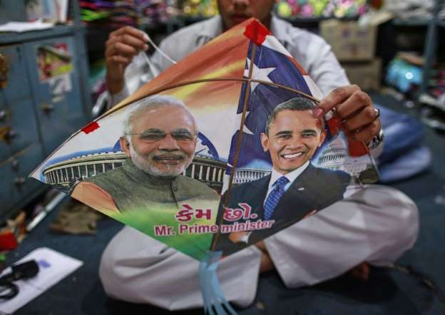 Employee ties threads on a kite, with portraits of Indian Prime Minister Narendra Modi and U.S. President Barack Obama, ahead of Obama's visit, in Mumbai: An employee ties threads on a kite, with portraits of Prime Minister Narendra Modi (L) and U.S. President Barack Obama, ahead of Obama's visit, in Mumbai January 23, 2015.