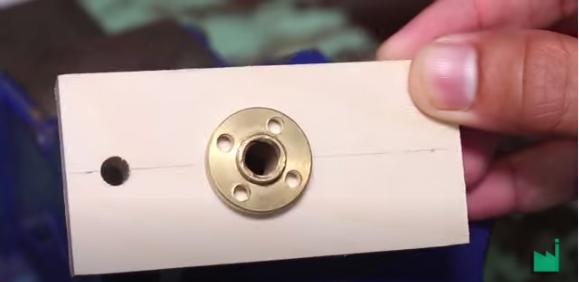 Metal insert in base of dispenser