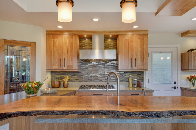 live edge wood countertop in a contemporary kitchen with hickory shaker kitchen cabinets