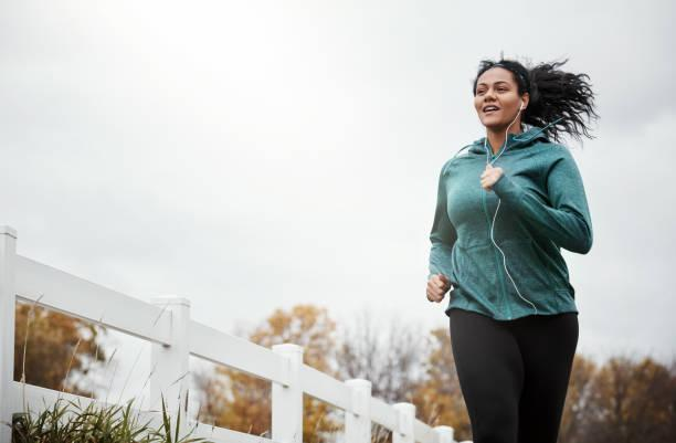 The perfect combo of fresh air and fitness Shot of an attractive young woman going for a run in nature cardio stock pictures, royalty-free photos & images