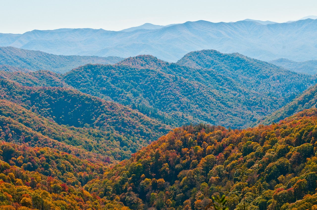 Colorful tree-covered hills in Great Smoky Mountains National Park, one of the best national parks to visit in the fall