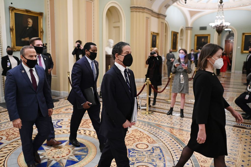 House Impeachment Lead Manager Representative Jamie Raskin (2nd R) and Impeachment Managers Representatives David Cicilline (L) Eric Swalwell (2nd L) and Joe Neguse (3rd L) depart after the Senate voted to acquit former U.S. president Donald Trump.