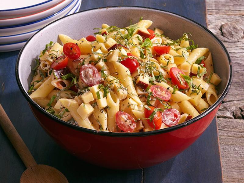 Spicy Pasta Salad with Smoked Gouda, Tomatoes and Basil in a red bowl