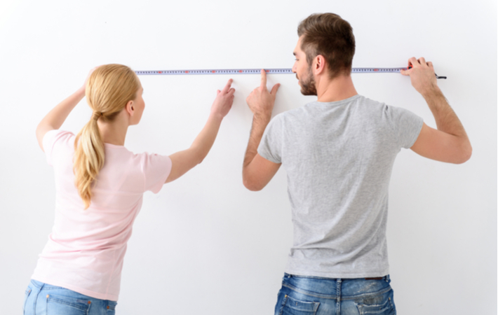 couple using a measuring tape